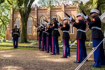 A rifle team of Marines from Truck Company, 23rd Marine Regiment, 4th Marine Division, perform a 21-gun salute at the gravesite of Gen. Robert H. Barrow, 27th Commandant of the Marine Corps.