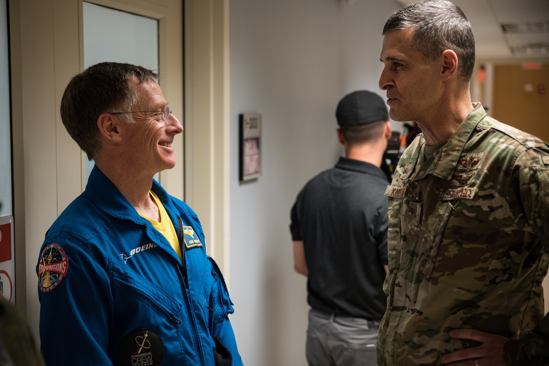 Brig. Gen. Mark Koeniger, 711th Human Performance Wing commander, speaks with Boeing astronaut Chris Ferguson during the two-day astronaut testing in the 711HPW's centrifuge Nov. 1 and 2.