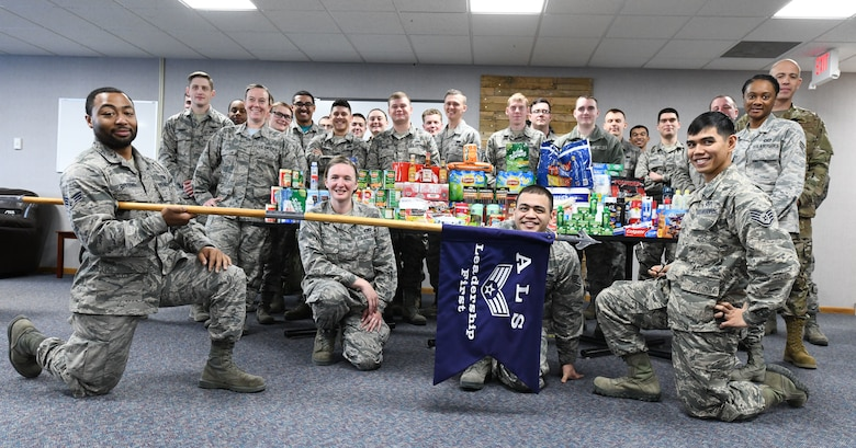 Airmen from Ellsworth Air Force Base, S.D., gather to prepare care packages to assist in the hurricane recovery and reconstruction efforts at Tyndall AFB, Fla., Nov. 1, 2018. The idea for the care packages was brought up by Senior Airman Lionel Gittens, a 28th Maintenance Squadron weapons loader, as part of an Airman Leadership School community involvement project. (U.S. Air Force photo by Airman 1st Class Thomas I. Karol)