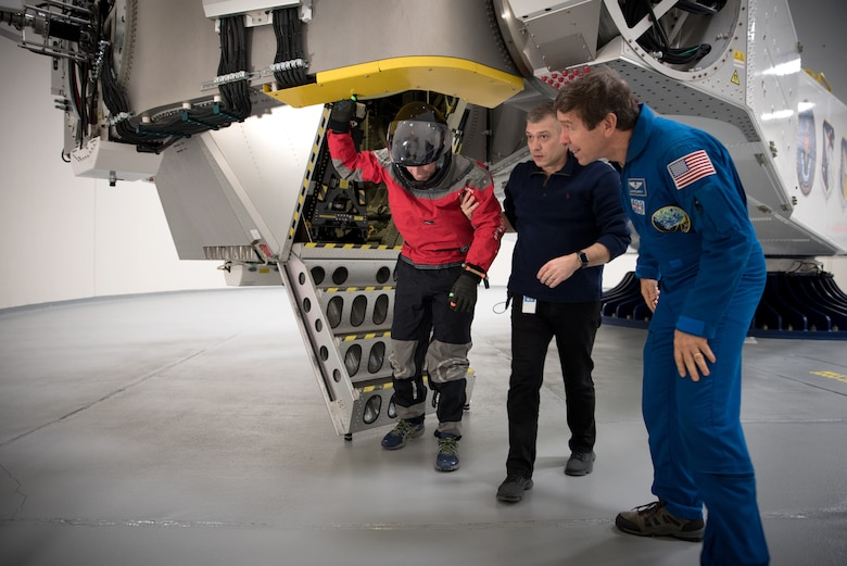 NASA spacesuit engineer Ian Meginnis is helped down from the centrifuge by KBRwyle contractor Brent Ochs with the Air Force Research Laboratory and NASA astronaut and physician Dr. Michael Barratt following his spin during centrifuge testing Nov. 1 and 2.