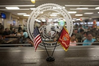 Flags are displayed during a birthday lunch at the Anderson Chow Hall, Marine Corps Base Hawaii, Nov. 11, 2018. Anderson Chow Hall held a birthday lunch celebrating the 243rd U.S. Marine Corps Birthday, serving steak, lobster, crab legs and cake. (U.S. Marine Corps photo by Sgt. Jesus Sepulveda Torres)
