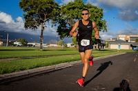 A contestant runs during the Turkey Trot 5k and 10k run, Marine Corps Base Hawaii, Nov. 3, 2018. The event, hosted by 3rd Radio Battalion and Marine Corps Community Services Hawaii, is an annual Thanksgiving-themed event that is open to U.S. Service members, their families, and civilian participants. The event promotes readiness and resiliency across the installation and local community by encouraging healthy, family-oriented activity. (U.S. Marine Corps photo by Cpl. Matthew Kirk)