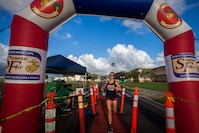 A contestant crosses the finish line during the Turkey Trot 5k and 10k run, Marine Corps Base Hawaii, Nov. 3, 2018. The event, hosted by 3rd Radio Battalion and Marine Corps Community Services Hawaii, is an annual Thanksgiving-themed event that is open to U.S. Service members, their families, and civilian participants. The event promotes readiness and resiliency across the installation and local community by encouraging healthy, family-oriented activity. (U.S. Marine Corps photo by Cpl. Matthew Kirk)