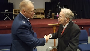 Col. Jay Smeltzer, commander of the 445th Maintenance Group, greets Keith McMurray, a WWII veteran at the City of Fairborn's Veterans Day Ceremony held at the Fairborn United Methodist Church November 10, 2018.