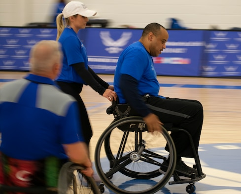 Tech Sgt. Robert Cowherd moves up the court during wheelchair basketball practice at the NE Region Warrior CARE Event at Joint Base Andrews, MD.