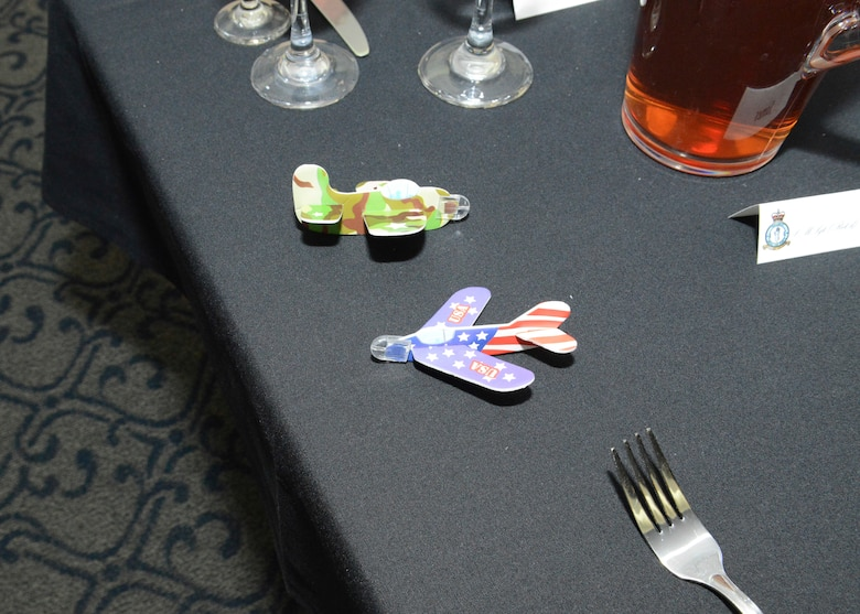 Little World War II-era airplanes were placed on each table at the Battle of Britain celebration held at Edwards AFB Nov. 9 at Club Muroc. (U.S. Air Force photo by Kenji Thuloweit)