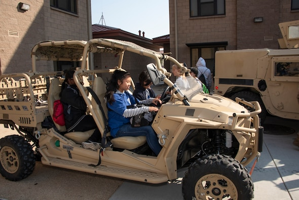 Students check out a security forces all-terrain vehicle during a base tour, Nov. 8, 2018, Travis Air Force Base, California. Travis hosted Junior Reserve Officer Training Corps students from three high schools in Northern Calif. Students learned about various career fields in the U.S. Air Force, toured static aircraft, a dormitory, and had the opportunity to talk with personnel about military life. (U.S. Air Force photo by Heide Couch)