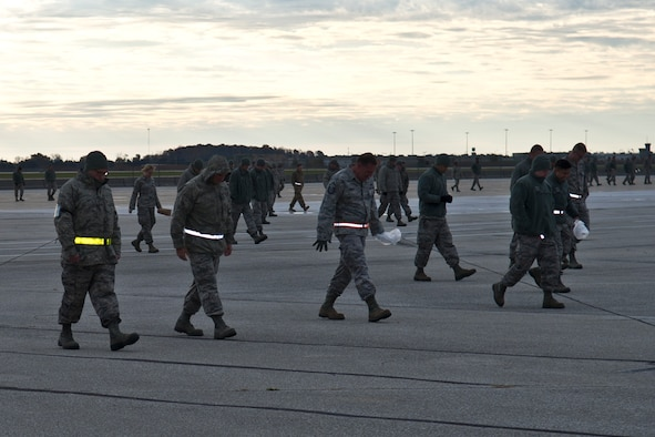 Airmen with the 434th Maintenance Group search the flightline for foreign object debris at Grissom Air Reserve Base, Ind., Nov. 4, 2018 on the flightline. Airmen found close to one pound of litter that was weighed and discarded by Quality Assurance Inspectors.  (U.S. Air Force photo by Staff Sgt. Courtney Dotson-Essett)