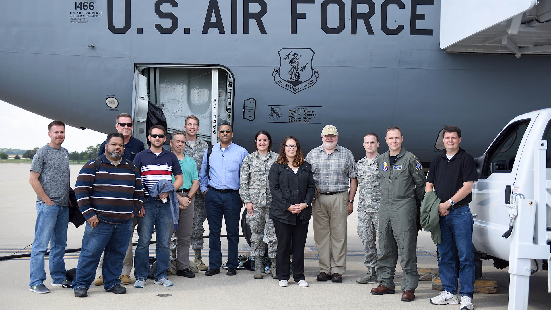 DCMA team stands in front of a KC-135 on the flight line.