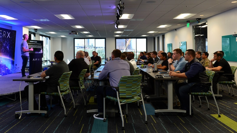 Airmen from the 432nd Wing/432nd Air Expeditionary Wing and the 799th Air Base Group receive a briefing about the AFWERX-Las Vegas, Nov. 5, 2018. AFWERX was envisioned by Secretary of the Air Force Heather Wilson to solve some of the toughest challenges that the Air Force faces through innovation and collaboration alongside the nation's top subject matter experts. (U.S. Air Force Photo by Airman 1st Class Haley Stevens)