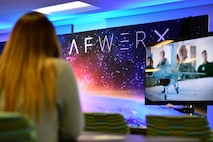 Airman 1st Class Danielle, 799th Security Forces Squadron security forces member, watches a video explaining the AFWERX mission Nov. 5, 2018, in Las Vegas. The off-site program served as an opportunity to get ideas flowing, accelerate results and learn more about the resources available to problem solvers. (U.S. Air Force Photo by Airman 1st Class Haley Stevens)