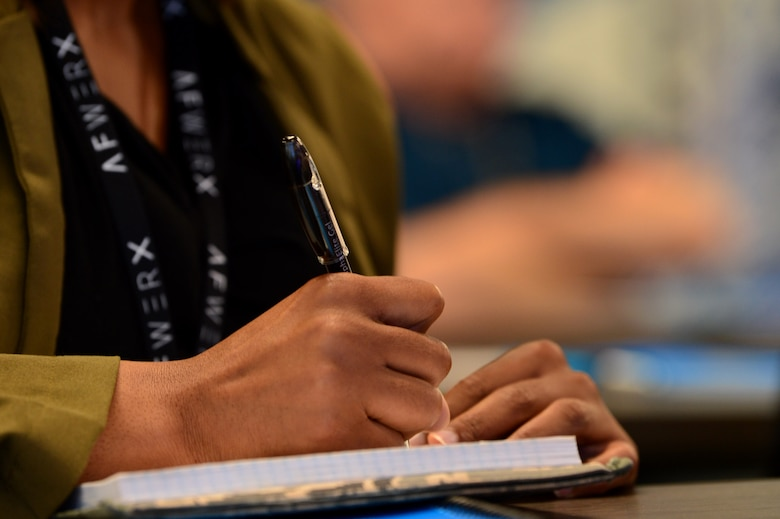Tech. Sgt. Courtney, 799th Security Forces Squadron security forces member, takes notes during an AFWERX Spark Cell workshop Nov. 5, 2018, in Las Vegas. Airmen visited to spark innovation and explore creative solutions to tactical-level problems. (U.S. Air Force Photo by Airman 1st Class Haley Stevens)