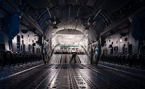 Loadmasters assigned to the 535th Airlift Sqadron, prepare a C-17 Globemaster III for cargo loading during Big Island Drop Week, Joint Base Pearl Harbor-Hickam, Hawaii Nov. 8, 2018. Big Island Drop Week is a quarterly training event conducted on the island of Hilo. (U.S. Air Force photo by Tech. Sgt. Heather Redman)