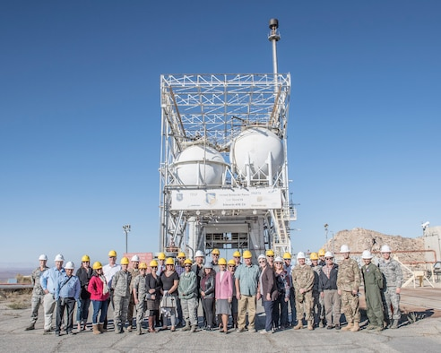 "Honorary Commanders pose for a photo in front of rocket engine test stand during a tour of the Air Force Research Laboratory ""Rocket Lab"" at Edwards Air Force Base, California, Nov. 9 (U.S. Air Force photo by Edward Cannon)"