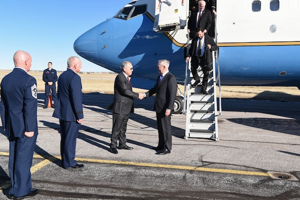 Jose Romualdez, Philippine Ambassador to the United States, Maj. Gen. Fred Stoss, 20th Air Force commander, and Chief Master Sgt. Thomas Good, 20th Air Force command chief, greets Defense Secetary James N. Mattis plade side Nov. 14, 2018, at Cheyenne Regional Airport, Wyo. Suring the Defense Secretary's visit to F.E. Warren Air Force Base, Wyo., the Bells of Balangiga were officially presented to the Philippine government. (U.S. Air Force photo by Airman 1st Class Abbigayle Wagner)
