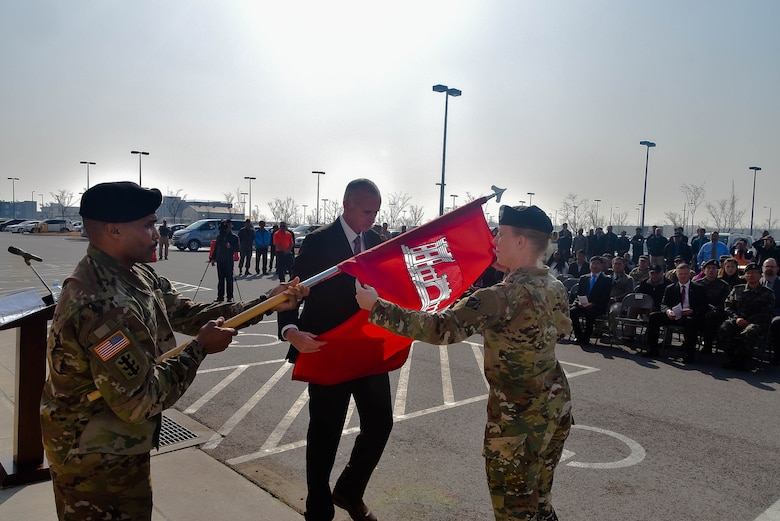 Col. Teresa Schlosser (right), U.S. Army Corps of Engineers (USACE), Far East District (FED) commander, and Richard Byrd (left), USACE FED Deputy District Engineer, prepare to unfurl the unit's colors during an uncasing ceremony held at the district's headquarters, Camp Humphreys, South Korea, Nov. 14.