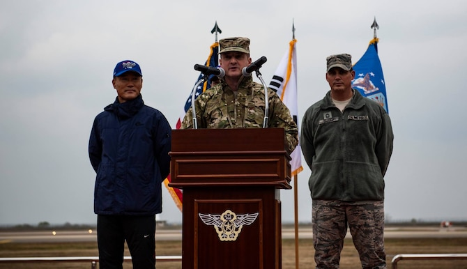 Col. John Bosone, 8th Fighter Wing commander, gives opening remarks for the 2018 US-ROKAF Friendship Day at Kunsan Air Base, Republic of Korea, Nov. 9, 2018. The US-ROKAF Friendship Day focused on celebrating the partnership and alliance between the 8th FW and 38th FG, who participated in several sporting events and competitions throughout the day. (U.S. Air Force photo by Senior Airman Stefan Alvarez)
