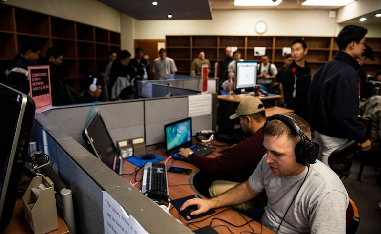 """8th Fighter Wing members face off with 38th Fighter Group personnel in a """"League of Legends"""" video game competition at Kunsan Air Base, Republic of Korea, Nov. 9, 2018. The US-ROKAF Friendship Day focused on celebrating the partnership and alliance between the 8th Fighter Wing and 38th Fighter Group, who participated in several sporting events and competitions throughout the day. (U.S. Air Force photo by Senior Airman Stefan Alvarez)"""