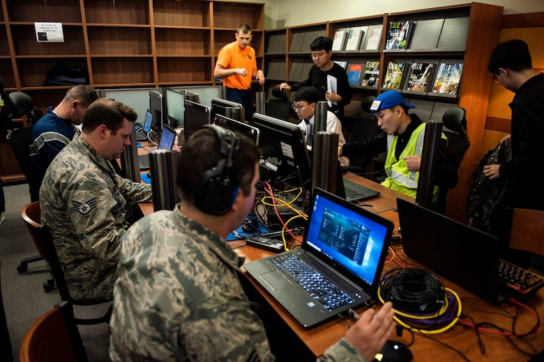 """8th Fighter Wing members face off with 38th Fighter Group personnel in the video game """"League of Legends"""" at Kunsan Air Base, Republic of Korea, Nov. 9, 2018. The US-ROKAF Friendship Day focused on celebrating the partnership and alliance between the 8th Fighter Wing and 38th Fighter Group, who participated in several sporting events and competitions throughout the day. (U.S. Air Force photo by Senior Airman Stefan Alvarez)"""