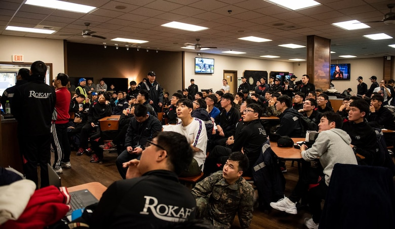 """8th Fighter Wing and 38th Fighter Group members spectate a """"League of Legends"""" video game match at Kunsan Air Base, Republic of Korea, Nov. 9, 2018. The US-ROKAF Friendship Day focused on celebrating the partnership and alliance between the 8th Fighter Wing and 38th Fighter Group, who participated in several sporting events and competitions throughout the day. (U.S. Air Force photo by Senior Airman Stefan Alvarez)"""