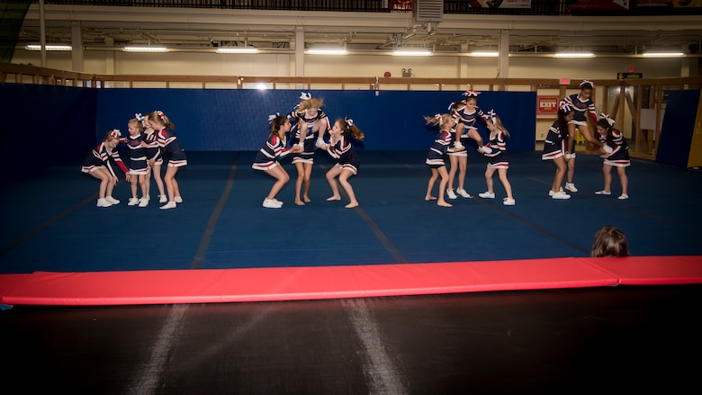 Cheerleaders show off their routine