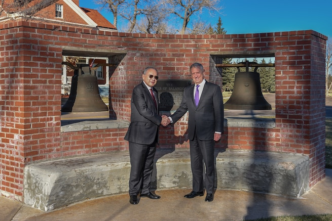 Jose Romualdez, Philippine Ambassador to the United States, and Defense Secretary James N. Mattis, stand for a photo, Nov. 14, 2018, in front of the bells of Balangiga on F.E. Warren Air Force Base, Wyo. During the visit, the Bells of Balangiga were officially presented to the Philippine government. (U.S. Air Force photo by Airman 1st Class Braydon Williams)