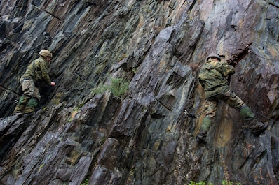 U.S. Marines with Special Purpose Marine Air-Ground Task Force-Crisis Response-Africa maneuver through a vertical assault course during Exercise Green Claymore at Ballachulish Quarry, in Ballachulish, Scotland, Nov. 1, 2018.