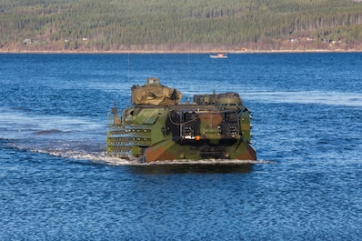 U.S. Marines with 24th Marine Expeditionary Unit conduct an amphibious landing in an Assault Amphibious Vehicle during Exercise Trident Juncture 18 in Alvund, Norway, Oct. 30, 2018.