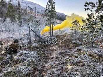 A U.S. Marine with Marine Rotational Force-Europe 19.1 (MRF-E), sets a marker during a squad attack as a part of Exercise Northern Screen in Setermoen, Norway, Nov. 28, 2018.