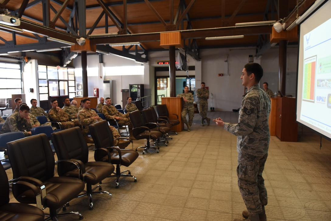 U.S. Staff Sgt. Jeovanni Horvath, 39th Medical Operations Squadron mental health technician, briefs members of the 728th Air Mobility Squadron on healthy sleeping habits at Incirlik Air Base, Turkey, Nov. 13, 2018.