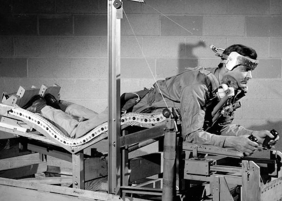 "U.S. Air Force Aeromedical Laboratory scientists test a prone-position ""pilot bed,"" on February 3, 1949. AFRL designed the bed to relieve the gravitational stress on pilots, as part of research to solve medical challenges presented by space flight. (U.S Air Force photo)"