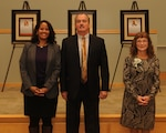 Carolyn Williford-Jackson (left), Keith Ford (center) and Jacqueline Basquill pose in front of framed plaques during the Defense Logistics Agency Troop Support Hall of Fame induction ceremony Nov. 13, 2018 in Philadelphia. The program honors former employees for their significant, enduring contributions to Troop Support. Ford and Basquill were inducted, and Williford-Jackson accepted the honor for her brother, Wayne Williford, who was inducted posthumously. Photo by Ed Maldonado.
