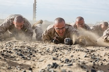 Recruits with Hotel Company, 2nd Recruit Training Battalion, crawl during a combat conditioning exercise at Marine Corps Recruit Depot San Diego, Nov. 14. Physical training is utilized to strengthen the body and develop a strong character embodying our core values through teamwork. Annually, more than 17,000 males recruited from the Western Recruiting Region are trained at MCRD San Diego. Hotel Company is scheduled to graduate Jan. 16.