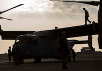 U.S. Marines with Marine Medium Tiltrotor Squadron 166 Reinforced, 13th Marine Expeditionary Unit, maintain an MV-22B Osprey after flight during the Bahrain International Airshow. BIAS, a biennial event, is an opportunity to strengthen military-to-military relationships with regional partners and European allies.
