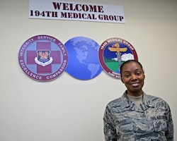 Master Sgt. Khalilah Oliver, a medical administrator assigned to the Washington Air National Guard's 194th Medical Group, stands in a reception area, Nov. 4, 2018. (U.S. Air Force photo by Airman 1st Class Mckenzie Airhar)