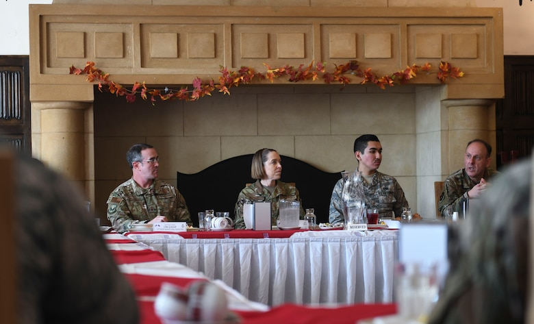 U.S. Air Force Air Education and Training Command command chiefs speak with first-term and newly retrained Airman during lunch to learn their perspective of the training process at RAF Mildenhall, England, Nov. 14, 2018. The purpose of their visit was to speak with Airmen and gain a better understanding of what they do to support Team Mildenhall, AETC and Air Force Special Operations Command. (U.S. Air Force photo by Airman 1st Class Alexandria Lee)