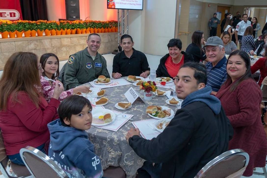 Col. Lee Gentile, 47th Flying Training Wing commander, sits at a table full of attendees at H-E-B's 26th annual Feast of Sharing, Nov. 11, 2018. The event, which gives a warm, full course Thanksgiving meal to anyone who desired, took time to thank those who help defend, or have defended, this great nation.