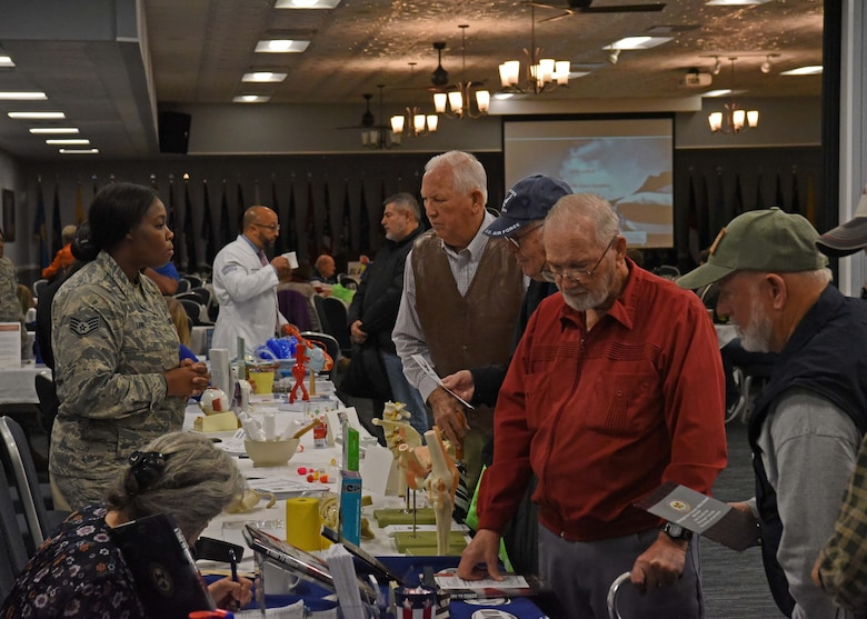 Military retirees visit information booths Nov. 9, 2018, during the Retiree Appreciation Day on Columbus Air Force Base, Mississippi. There are more than 5,700 military retirees in a 50-mile radius of Columbus Air Force Base, Mississippi. (U.S. Air Force photo by Staff Sgt. Joshua Smoot)