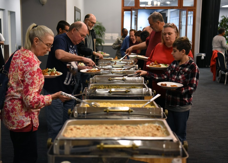 Retirees fill their plates Nov. 9, 2018, during the Retiree Appreciation Day on Columbus Air Force Base, Mississippi. During the event, retirees were treated with a free lunch buffet, raffle prizes, a medical expo and free flu shots. (U.S. Air Force photo by Staff Sgt. Joshua Smoot)