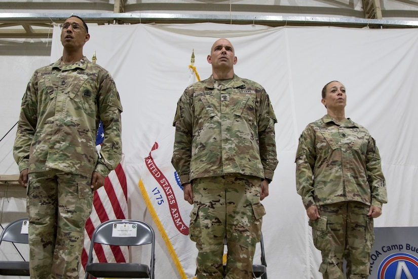 From left, U.S. Army Master Sgt. Otoniel Rivera, Chief of Training for the Camp Buehring Noncommissioned Officer Academy, U.S. Army Command Sgt. Maj. Joseph Cornelison, command sergeant major of U.S. Army Central, and U.S. Army Command Sgt. Maj. Donna Ortiz, commandant of the Camp Buehring NCOA, sing the Army Song during the graduation ceremony of the latest class of the Basic Leader Course at Camp Buehring, Kuwait, Oct. 17, 2018. The NCOA in Camp Buehring prepares junior Soldiers for leadership positions within their units while deployed overseas.