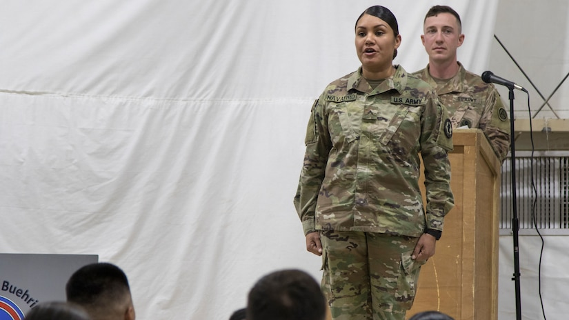 A U.S. Army Soldier graduating from the latest Basic Leader Course at the U.S. Army Central Noncommissioned Officer Academy calls out her name before she walks across the stage at the graduation ceremony held in Camp Buehring, Kuwait, Oct. 17, 2018. Completing BLC is an essential task which prepares Soldiers to be more capable noncomissioned officers.