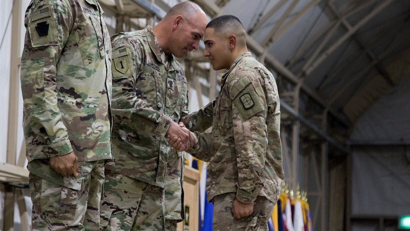 U.S. Army Command Sgt. Maj. Joseph Cornelison, command sergeant major of U.S. Army Central, congratulates a Soldier graduating the latest Basic Leader Course at Camp Buehring, Kuwait, Oct. 17, 2018. The graduates will return to their deployed units as more capable Soldiers, prepared for leadership positions.