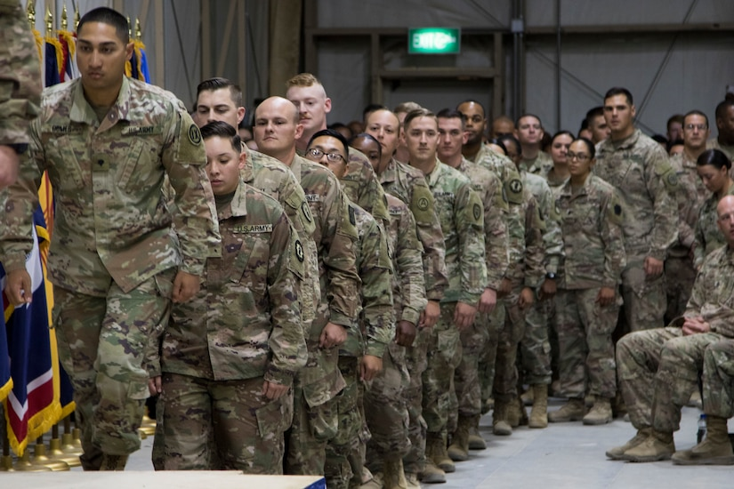U.S. Army Soldiers line up before they walk across the stage during their graduation ceremony for Basic Leader Course class 18-710 at Camp Buehring, Kuwait, Oct. 17, 2018. The graduates will return to their deployed units as more capable Soldiers, prepared for leadership positions.
