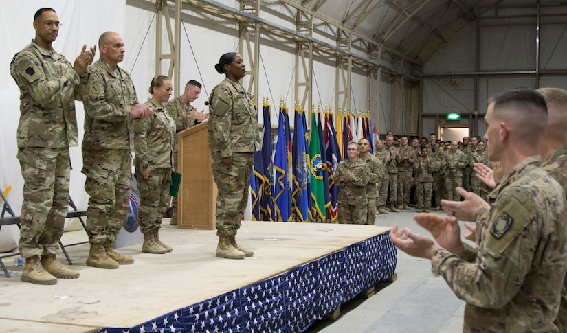 U.S. Army Cpl. Markitta A. Carter, the distinguished honor graduate of class 18-710 of the U.S. Army Central Basic Leader Course, calls out her name as she crosses the stage during the class graduation ceremony at Camp Buehring, Kuwait, Oct. 17, 2018. The Noncommissioned Officer Academy in Camp Buehring prepares junior Soldiers for leadership positions within their units while deployed overseas.