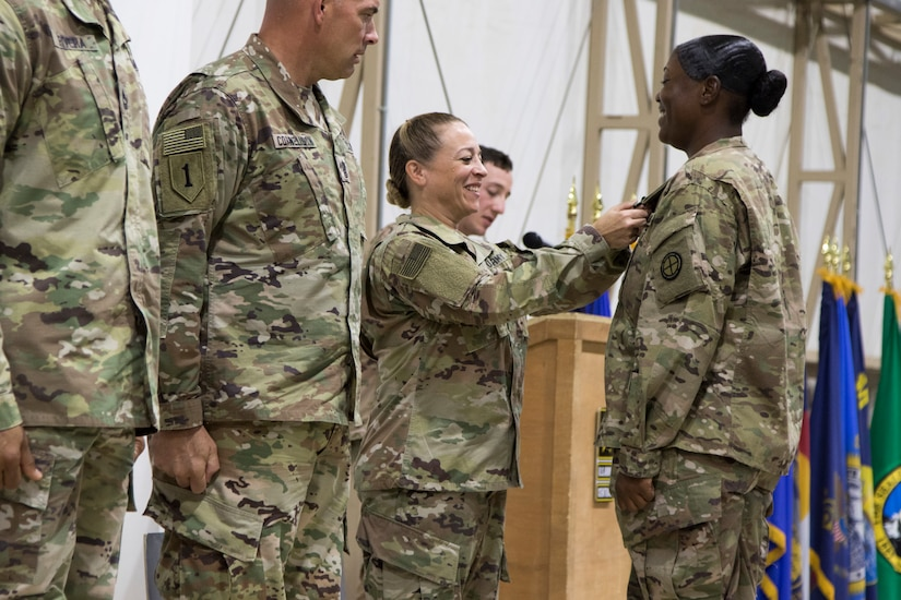 U.S. Army Command Sgt. Maj. Donna Ortiz, commandant of the Camp Buehring Noncommissioned Officers Academy, awards Cpl. Markitta A. Carter, the distinguished honor graduate of U.S. Army Central Basic Leader Course class 18-710, with an Army Achievement Medal during the class graduation ceremony at Camp Buehring, Kuwait, Oct. 17, 2018. Developing a prepared and capable leader is one of the Army's modernization efforts.