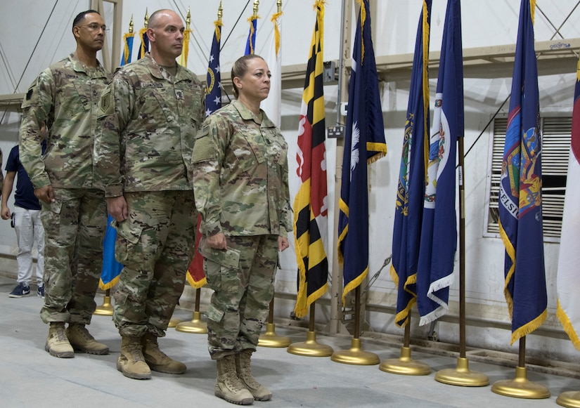 From left, U.S. Army Master Sgt. Otoniel Rivera, Chief of Training for the Camp Buehring Noncommissioned Officer Academy, U.S. Army Command Sgt. Maj. Barry Parker, command sergeant major of the 150th Brigade Engineer Battalion, and U.S. Army Command Sgt. Maj. Donna Ortiz, commandant of the Camp Buehring NCOA, preside over the newest graduating class of Soldiers from the Basic Leader Course at Camp Buehring, Kuwait, Oct. 17, 2018. The NCOA in Camp Buehring prepares junior Soldiers for leadership positions within their units while deployed overseas.