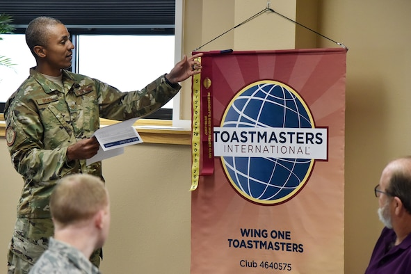 Tech. Sgt. Ritchie Brown, 741st Missile Security Forces Squadron member and Toastmasters president, unveils an accolade Nov. 7, 2018, at Malmstrom Air Force Base, Mont.