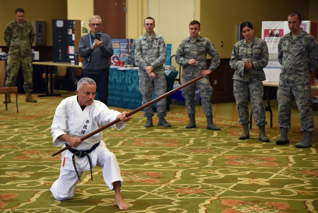 Alfred Rivera, Okinawa Kenpo Mushin Ryu instructor, provides a karate demonstration during Diversity Day inside the Bay Breeze Event Center at Keesler Air Force Base, Mississippi, Nov. 13, 2018. The celebration also included food sampling and information booths about countries around the world. (U.S. Air Force photo by Kemberly Groue)