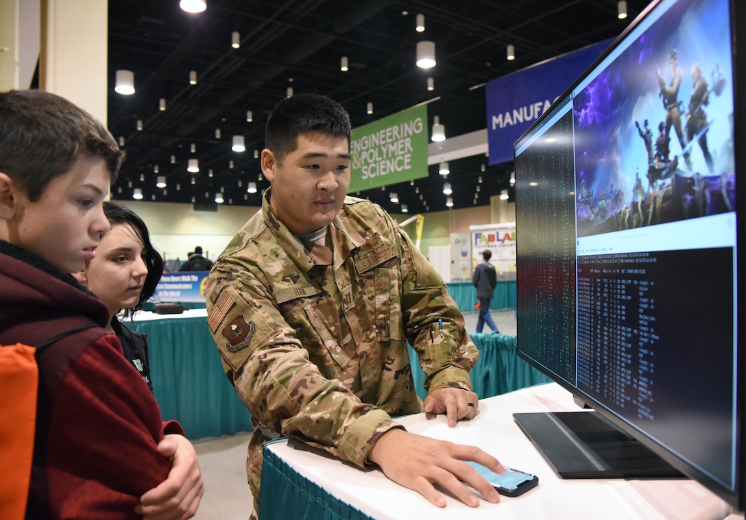 U.S. Air Force Capt. Jonathan Han, 333rd Training Squadron instructor, provides a cyber demonstration to West Wortham Middle School students during the Pathways to Possibilities event at the Mississippi Coast Coliseum in Biloxi, Miss., Nov. 14, 2018. The event is an interactive career expo designed for all eighth graders in private and public schools in the six lower counties of Mississippi. The purpose of the event, set forth by the Mississippi Department of Education, is to help encourage a direction for the students high school pathway choice and is linked to the Common Core state standards. (U.S. Air Force photo by Kemberly Groue)