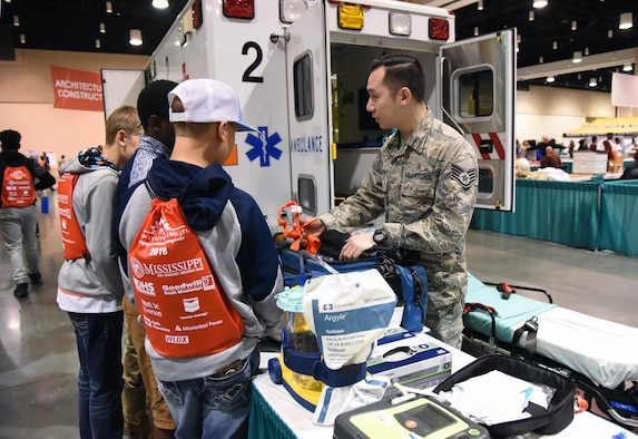 U.S. Air Force Staff Sgt. Bob Keophakdy, 81st Medical Operations Squadron emergency room technician, shows medical equipment to Leakesville Middle School students during the Pathways to Possibilities event at the Mississippi Coast Coliseum in Biloxi, Miss., Nov. 14, 2018. The purpose of the event, set forth by the Mississippi Department of Education, is to help encourage a direction for the students high school pathway choice and is linked to the Common Core state standards. (U.S. Air Force photo by Kemberly Groue)